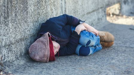 Young homeless boy sleeping on the bridge. Picture: Getty Images/iStockphoto