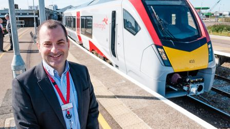 Greater Anglia managing director, Jamie Burles, with a new Stadler bimode train at Lowestoft earlier
