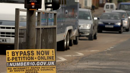 Campaigners have long been calling for an A140 bypass at Long Stratton. Pictured is a sign in 2007.