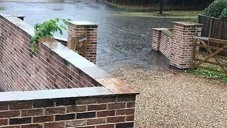 Flooding outside the Wolsey's home in Worlingham. Photo: Wolsey