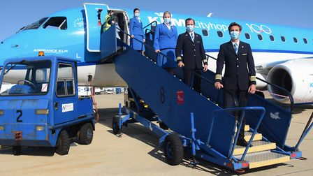 The crew from the first KLM flight from Amsterdam at Norwich Airport as the route restarts. From rig