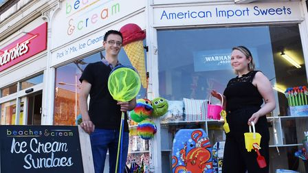 Pete Woodward, owner of Beaches And Cream on Station Square, Lowestoft with shop assistant Tersha Tu