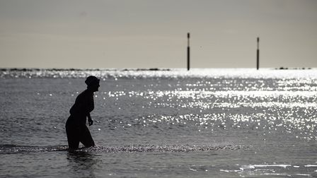 Tracy Clark swimming at Sea Palling beach. Picture: MARK BULLIMORE