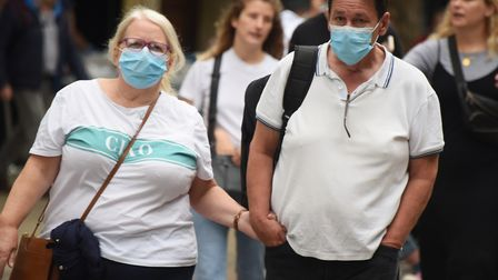 Shoppers out in force wearing masks in Norwich city centre on the first day it became mandatory for