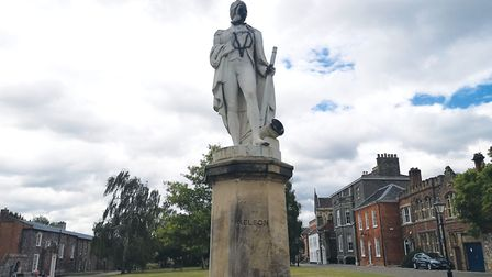 Black graffiti has been sprayed onto the Nelson statue at Norwich Cathedral. Picture: Ruth Lawes
