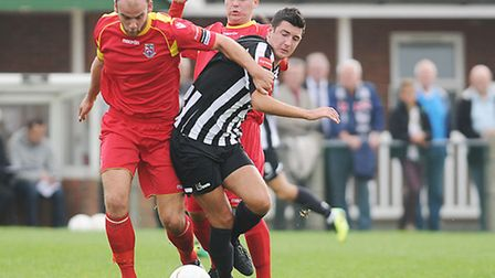 Dereham Town, black and white, are playing away again in the next few days. Picture: IAN BURT