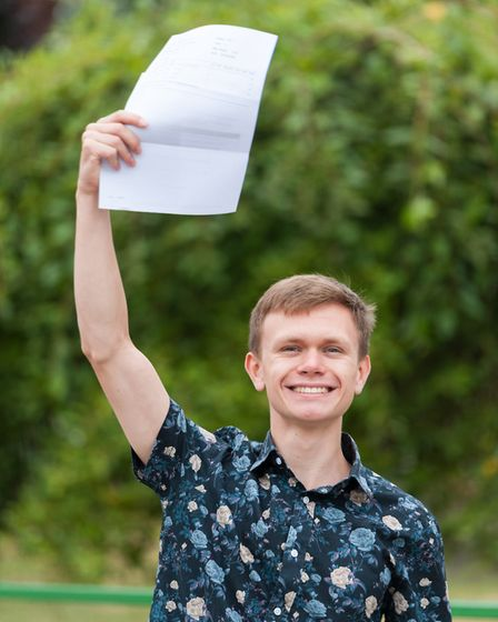 Springwood student Joseph Pembrey with his A-Level results. Picture: Ian Burt