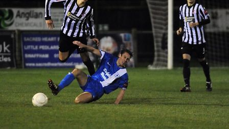 Dereham's Ryan Hawkins was caught by this challenge in the first half on Tuesday night. Picture: Ian