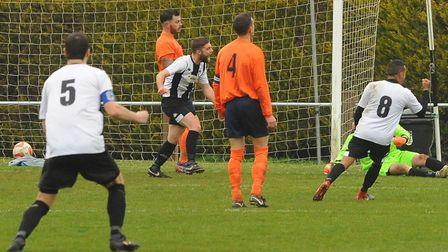 Diss Town played an FA Cup tie following a coronavirus scare. Pictured is action from a previous mat