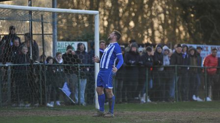 Grant Holt in action for Wroxham in the FA Vase last season against AFC Bitton. Picture: Tony Thruss