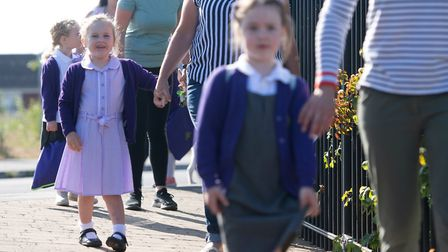 Parents drop off pupils at Queen's Hill Primary School in Costessey on the limited return of some pu
