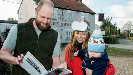 Alex Begg with Laura Cross and her son Freddie in front of the Swan at Gressenhall. Laura is wearing