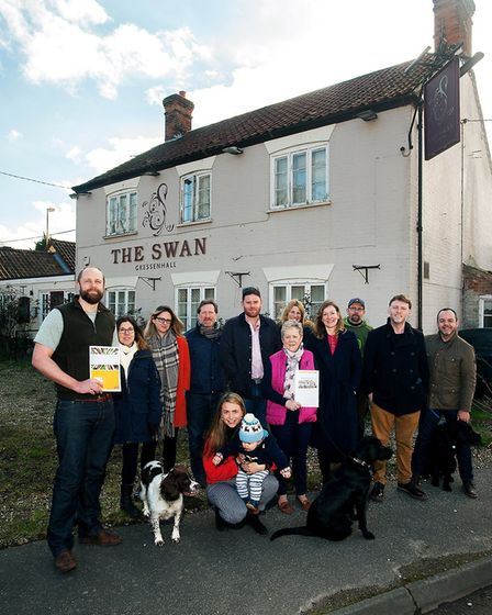 Community members in front of the Swan pub in Gressenhall, which they are hoping to reopen as a comm