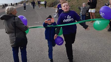 Lewis Walker at the end of his 50-mile walking challenge underataken during August. The ten-year-old