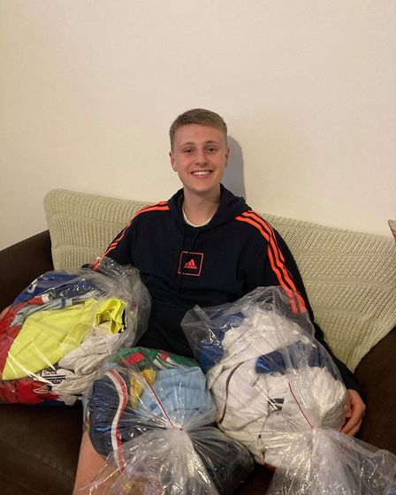 Ellis at home with some of his football shirt collection. Picture: Ellis Platten