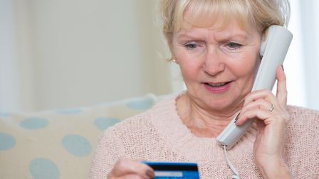 Police have warned that fraudsters posing as officers are attempting to talk elderly people into giv