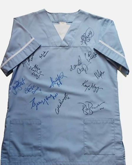 The scrub is being auctioned off in aid of The Big C Charity and has been signed by the Holby City c