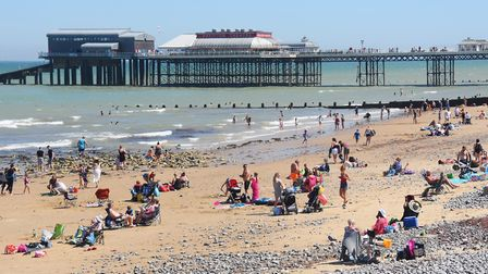 A busy Cromer beach on one of the hottest days of summer - but will it soon be empty again? Picture: