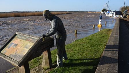Water laps over the Reedham Quay moorings in the aftermath of Storm Ciara. Picture: DENISE BRADLEY