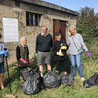 Volunteers taking part in the clean up of a former RAF Radar Station on Barrow Common in Brancaster