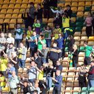 The Norwich fans celebrate their side's 2nd goal during the Sky Bet Championship match at Carrow Roa