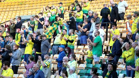 Norwich City fans celebrate after Teemu Pukki scores his side's first goal of the game at Carrow Roa
