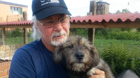 The late Gavin Gamby-Boulger with Humphrey in need of love in Bulgaria. Photo: Supplied by Wetnose