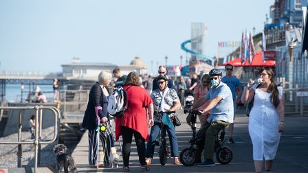 People enjoying the sun on Cromer's prom Picture: SARAH LUCY BROWN