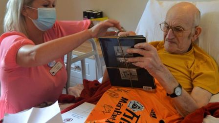 Brian Parker receiving his gifts from around the country at the Laurel Lodge care home in Norwich. P