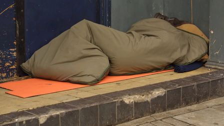 A generic photo of a homeless person sleeping in a doorway. Photo: Getty Images/iStockphoto