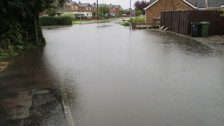 Flooding on the junction of Lavender Grove and Orchid Avenue in Toftwood. Picture: Mick Hillocks