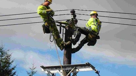 Engineers working to repair power lines amid heavy winds Picture: UK Power Networks