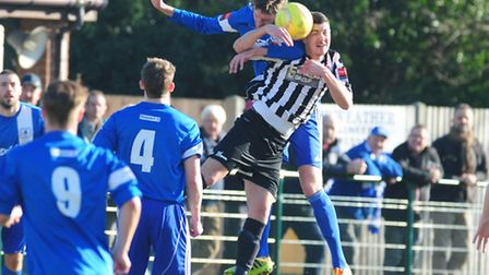 Craig Bussens, black and white, in action before he was seriously injured against Wroxham. PictureL