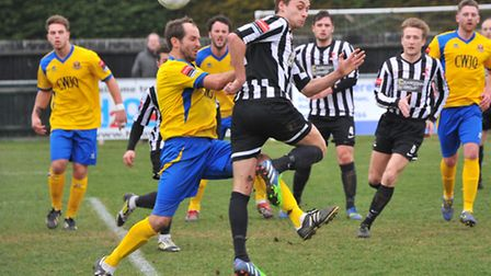 Dereham Town, black and white, in recent Ryman North action. Picture: SIMON FINLAY