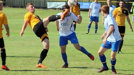 Danny Williams puts his head in during Fakenham Town's weekend defeat at Stanway. Picture: TONY MILE