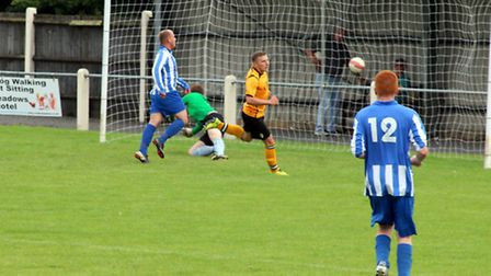 Connor Walker finds the net during Fakenham Town Reserves' 6-1 friendly win over Mattishall at Clipb