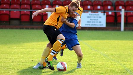A Dersingham player gets to grips with the Ghosts' Kyle Plumb. Picture: TONY MILES