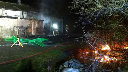 Firefighters stopped a blaze that destroyed 400 plastic crates from spreading to a building