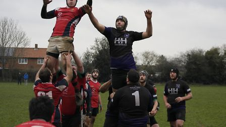 Dereham's Richard Dunsire, right, tries to spoil a Medics line-out. Picture: KIRSTY DREW