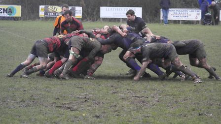 Wymondham and Dereham forwards, right, struggle for traction on Saturday. Picture: KIRSTY DREW