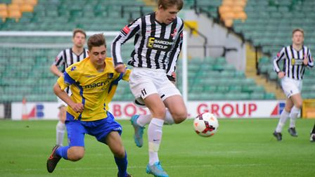 Action from the Norfolk Senior Cup final between Dereham, black and white, and Norwich United. Pictu