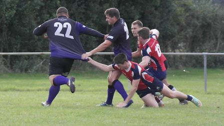 Dereham captain and stand-in fly half, Marcus Evans makes a break for the line during the recent def