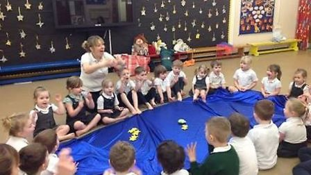 Maria Holloway from Tiny Talk teaches space themed signs at Toftwood Infant School for Book Week. P