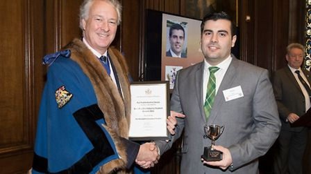 """Rui Pedros Gomes Sousa, right, was awarded """"Best Poultry Industry Student"""" by The Master of the Wors"""