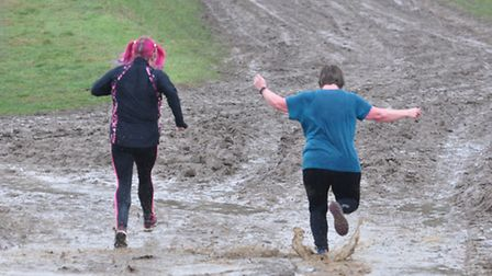 Beach runners tackle the mud at the Hunny Bell cross-country. Picture: Submitted