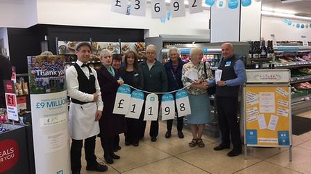 Dereham's Co-operative supermarket presents a cheque to Caring Friends for Cancer charity. Picture: