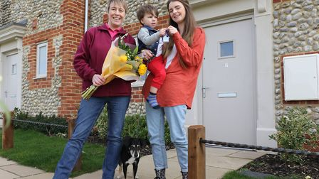 Caitlin Finan and two year old Alfie received the keys to her new home from Christine Candlish of Vi