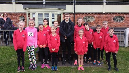 Dereham junior runners line up for a team picture at Great Yarmouth. Picture: Dawn Protheroe