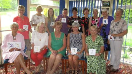 Dereham Ladies' captain Dianne Wilkinson with all the winners at the club's closed meeting. Picture: