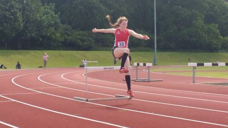 Abi Foster winning the 300m hurdles. Picture: Club